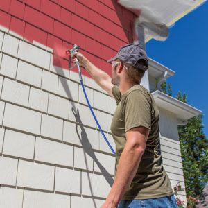 Source: http://magnum.graco.com/projects/exterior/ man painting the exterior of a house